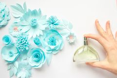 Concept flower arrangement. Flowers, fragrance, perfume. Delicate. Women`s hand spray perfume. Flower arrangement. Flowers, fragrance, perfume on white royalty free stock images