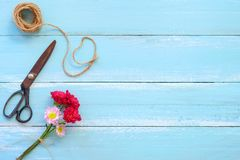 Colorful flowers bouquet on blue wooden background. Stock Images