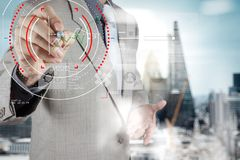 Concept of focus on target with digital diagram,graph interfaces. Virtual UI screen,connections netwoork.Hipster finance analist working at trendy office royalty free stock photo