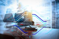 Young creative designer man working at office with computer laptop as concept. Concept of focus on target with digital diagram.Young creative designer man royalty free stock image