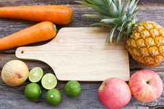 Concept of food background. Variety fruits on wood background. Stock Photography