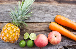 Concept of food background. Variety fruits on wood background. Stock Photos