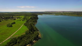 Concept freedom flying ever lake. Aerial shot Glenmore reservoir Alberta Canada stock video footage