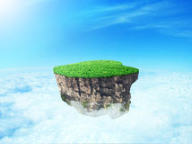 Concept of freedom. Island in sky with clouds and green grass on sky background Stock Images