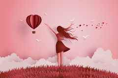 Concept of  freedom love. And valentine day,Beautiful girl stretches her arms on the sky with paper heart balloon.paper art and craft style Stock Photo