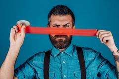 Concept freedom of speech and press. man wrapping mouth by adhesive tape. censorship. Brutal bearded male. International. Human Right day. Mind control and royalty free stock image