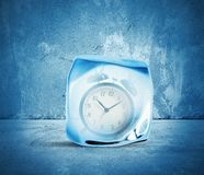Concept of freeze time. With alarm inside the ice Stock Image