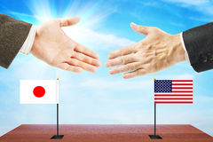 Concept of friendly relations between United States and Japan Royalty Free Stock Photos
