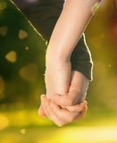 Concept of friendship and love of man and woman. Concept shoot of friendship and love of man and woman: two hands over sun ray and nature Stock Photography