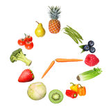 Concept fruits and vegetables clock on white Royalty Free Stock Images