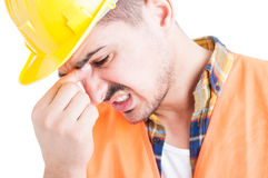 Concept of frustration with an engineer with headache in closeup Royalty Free Stock Photography
