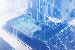 The concept of future technologies. Computer board with visual effects in a futuristic style. Automation of machine. Assembly of computer circuit board. The Royalty Free Stock Image