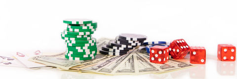 Concept gambling in las vegas, Casino chips, playing cards and d. Ollar Banknotes, panorama royalty free stock photography