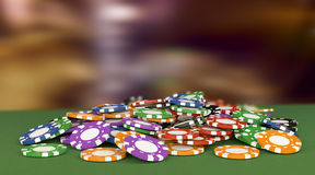 Concept of gambling. Pile of fiches on a green table, concept of gambling (3d render Stock Photo