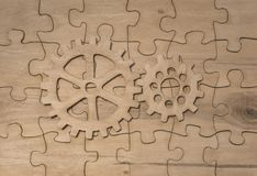 Gears on the background of puzzles Royalty Free Stock Image