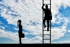 Concept of gender inequality and discrimination against women in their careers. Silhouette of workers, a man climbs the career ladder instead of a woman. The stock photography