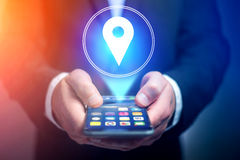 Concept of geographical localization on a map with a smartphone. View of a Concept of geographical localization on a map with a smartphone royalty free stock image