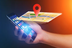 Concept of geographical localization on a map with a smartphone. Vuiew of a Concept of geographical localization on a map with a smartphone royalty free stock image