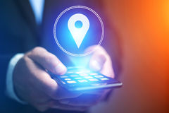 Concept of geographical localization on a map with a smartphone. Vuiew of a Concept of geographical localization on a map with a smartphone royalty free stock photography