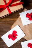 Concept of gift cards on wooden background top view.  royalty free stock photo