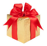 Concept gift - a gold box with a red bow Stock Photo