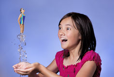 Concept of girl diving from hands. Royalty Free Stock Photos