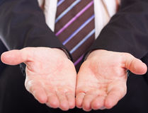 The concept of giving - Businessman. 's open palm Royalty Free Stock Images