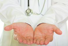 The concept of giving - Doctor. 's open palm Stock Images