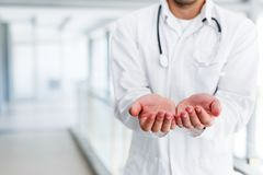 The concept of giving doctor`s open palm. Hands pharmacy mock up Stock Photography