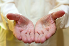 The concept of giving - Elderly man. 's hands Royalty Free Stock Image