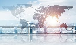 Concept of global communication and networking with world map over cityscape stock image