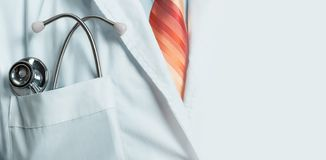 Medicine, Healthcare, Insurance Concept. Doctor with stethoscope, closeup with copy-space royalty free stock image