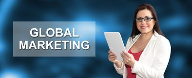 Concept of global marketing. Woman using digital tablet with global marketing concept on background royalty free stock image