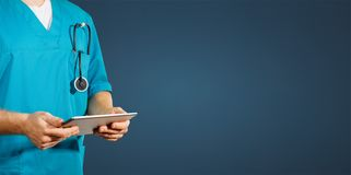 Concept of global medicine and healthcare. Doctor holds digital tablet. Diagnostics and modern technology blue back. Concept of global medicine and healthcare royalty free stock image