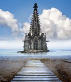 Concept for global warming. A Cathedral half sunk in a sea of water Royalty Free Stock Image