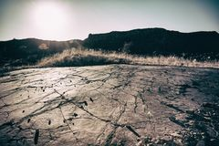 The concept of global warming is a cracked scorched earth soil d. Rought desert landscape dramatic sunset. Conceptual landscape and toning Royalty Free Stock Photos