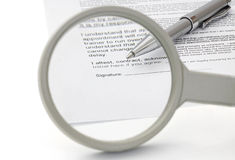 Concept of good contract with magnifying Glass Royalty Free Stock Photos
