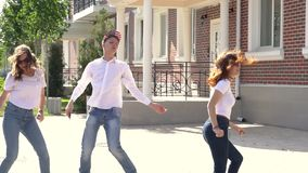 Concept of good news three girls boy dance in the street after reading message stock footage