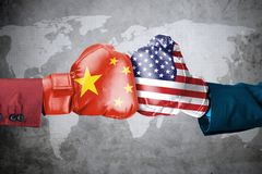 China conflict with USA. Concept of government conflict. Two hands of wearing boxing gloves with China and USA flag. Shot with world map background royalty free illustration