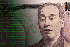 Concept graphic depicting Fintech on Japanese 10000 bill. Light green binary numbers on Japanese 10000 bill which expresses the concept of the finance innovation Stock Photography