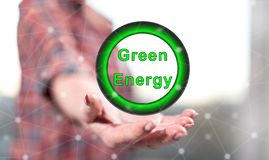 Concept of green energy. Green energy concept above the hand of a woman in background royalty free stock photos
