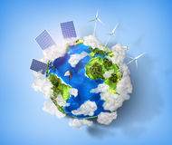 Concept of green energy and protect enviroment nature. Green pla. Net earth with batteries of solar energy and wind power installed on it Stock Photos