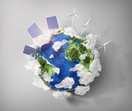 Concept of green energy and protect enviroment nature. Green planet earth with batteries of solar energy and wind power installed on it Royalty Free Stock Image