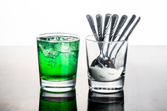 Concept of green fizzy drinks with unhealthy sugar content Royalty Free Stock Photo