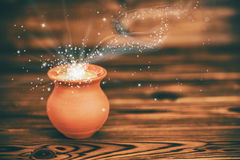 Concept greeting card of clay pot with mystical miracle light on Stock Images