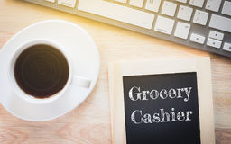 Concept Grocery Cashier message on wood boards. Royalty Free Stock Photos