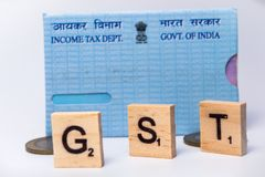 Concept of GST with indian PAN Card on isolated background royalty free stock photos