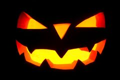 The concept of Halloween. The ghastly, ghastly pumpkin glows wit Royalty Free Stock Photo