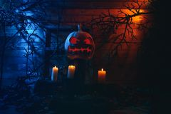 Concept of Halloween. glowing orange and blue light with angry t stock photo