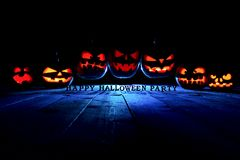 The concept of Halloween. Three glowing fiery light of evil scar royalty free stock photos